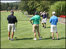 Men on the golf course at a Chapter golfing event.